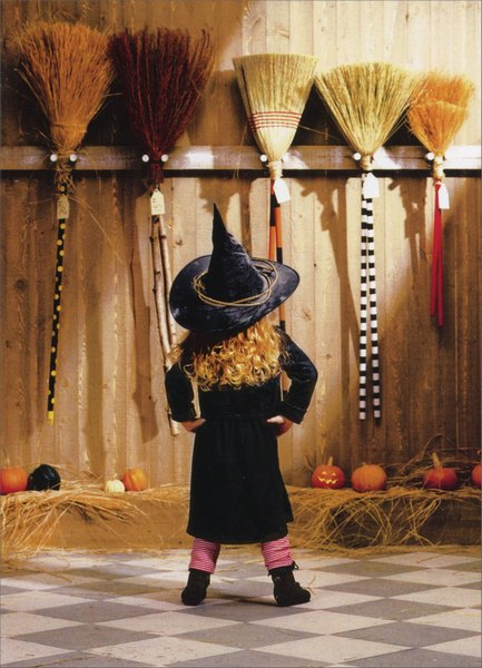 Little Witch Choosing A Broom (1 card/1 envelope) Funny Halloween Card - FRONT: No Text  INSIDE: A girl's got to accessorize!  Happy Halloween