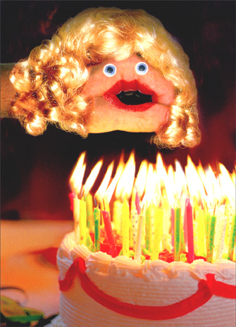 Hand Puppet Blowing Candles (1 card/1 envelope) Birthday Card - FRONT: No Text  INSIDE: A big hand for the little lady! Happy Birthday