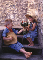 Boy Gives Girl Flowers on Steps (1 card/1 envelope) - Love Card - FRONT: Love�  INSIDE: You have touched my heart with love and happiness.