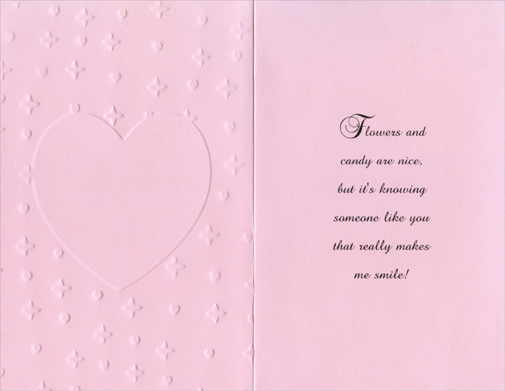 White Embossed Heart on Pink Stitches (1 card/1 envelope) Freedom Greetings Valentine's Day Card - FRONT: Happy Valentine's Day  INSIDE: Flowers and candy are nice, but it's knowing someone like you that really makes me smile!
